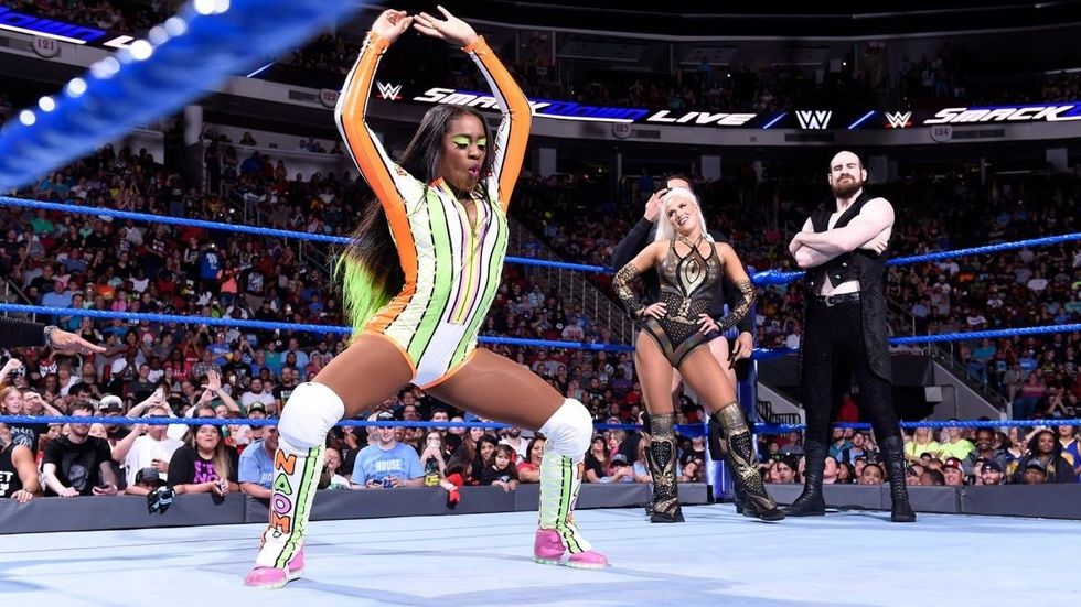 pro wrestler Naomi performs a dance-off in a squat