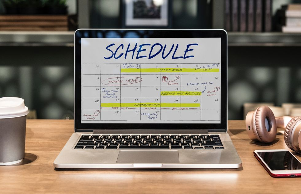 https://www.pexels.com/photo/macbook-pro-turned-on-displaying-schedule-on-table-1893424/