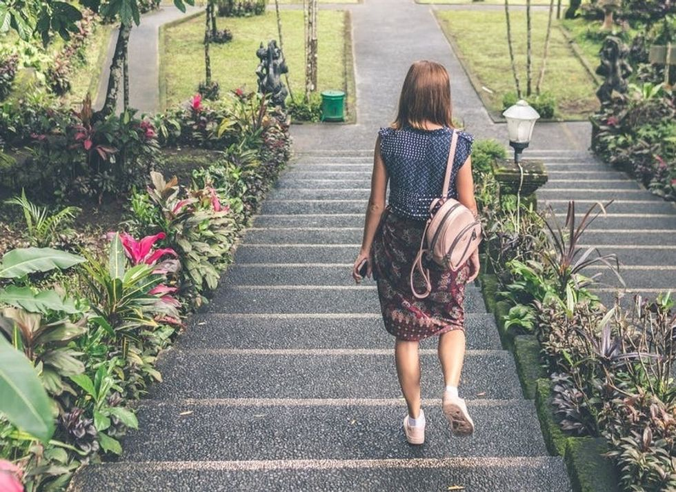 https://www.pexels.com/photo/woman-in-blue-and-red-dress-walking-down-the-stairs-929162/