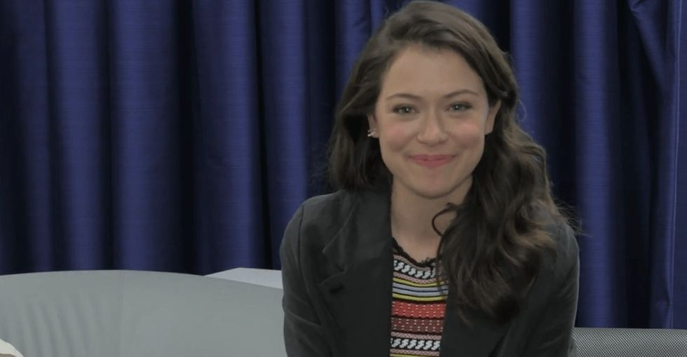 Orphan Black's Tatiana Maslany tears up when asked about her support for the show's LGBTQ fanbase.