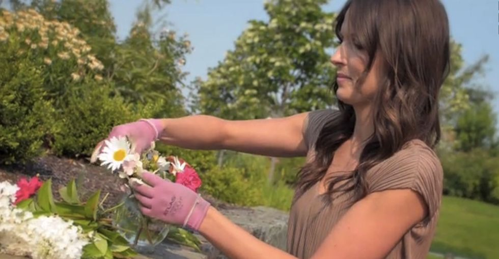 Most people throw away tons of flowers after their wedding. She puts them back to work.