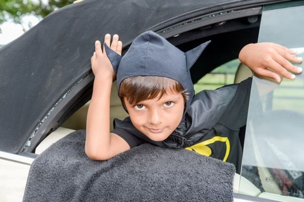 5-year-old saves baby from peril, dressed as Batman. This is not pretend. It really happened.