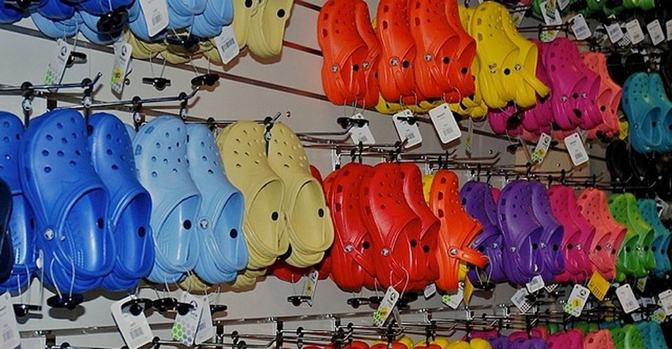 Why are 34,000 people being forced to wear orange Crocs?