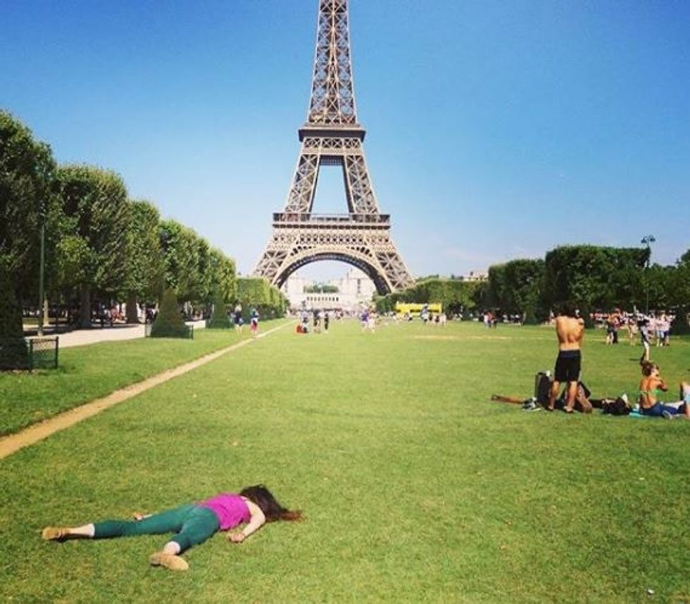 This artist is fighting back against selfie culture by 'dying' at the world's most popular landmarks.