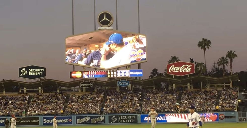 A baseball team showed a gay couple on the 'kiss cam.' Here's how the crowd reacted.
