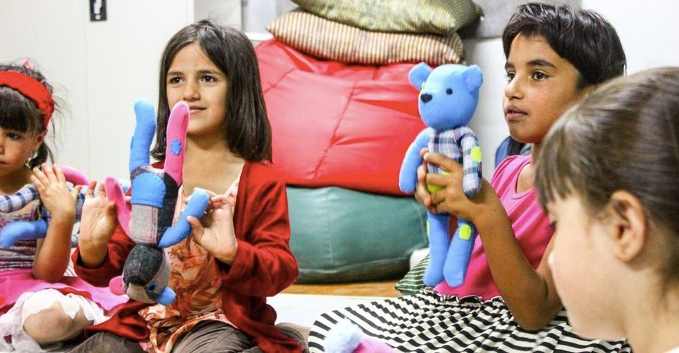 These cuddly teddy bears deliver a dose of delight to kids in refugee camps.
