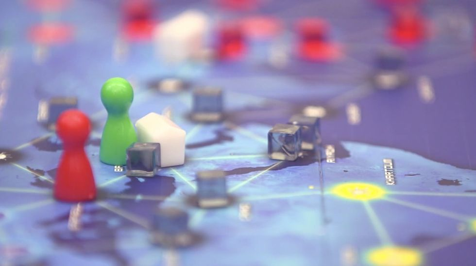 A popular board game gets rid of competition and gives players a more meaningful goal: teamwork.