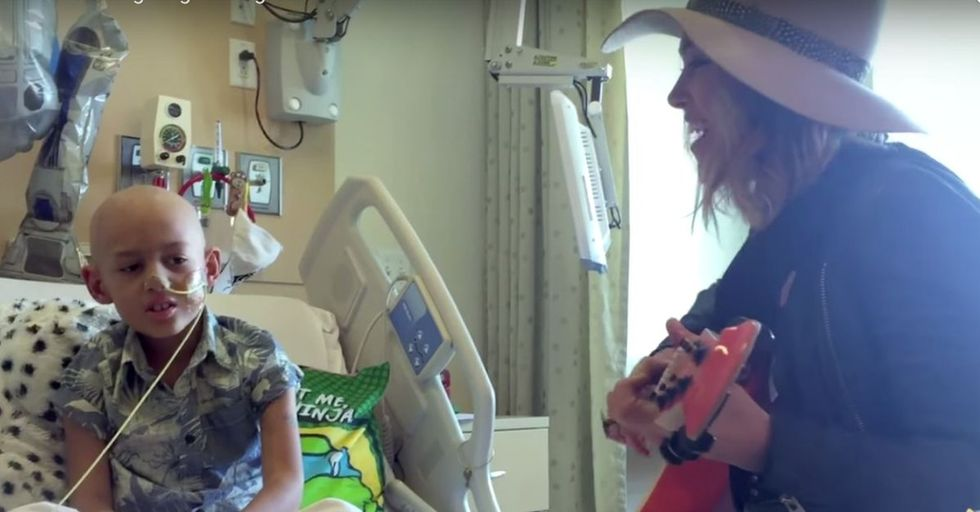 A singer of a popular song got invited to her fan's bedside. Her song took on a whole new meaning.