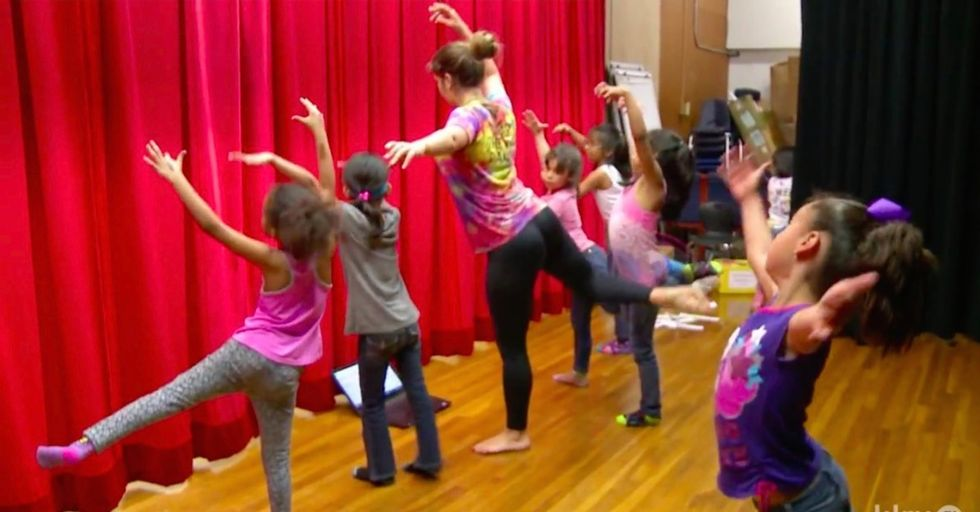 A dance class for young girls learning to speak English. It's fun, and it works.