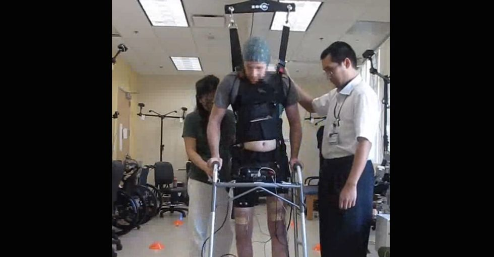 He's been paralyzed for 5 years, but he just walked. The video is spectacular.