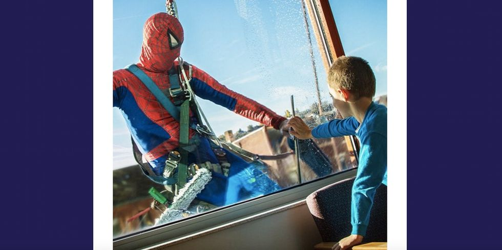 10 photos of superheroes washing windows and delighting children.