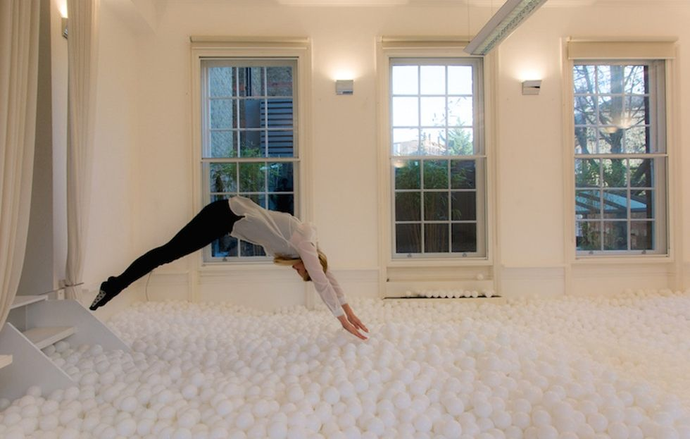 11 amazingly fun photos of adults playing in a ball pit, plus why science says play matters.