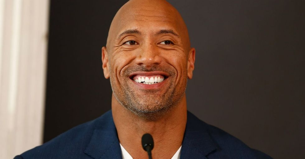 A fan with cancer was 'embarrassed about his bald head,' so The Rock stepped in.