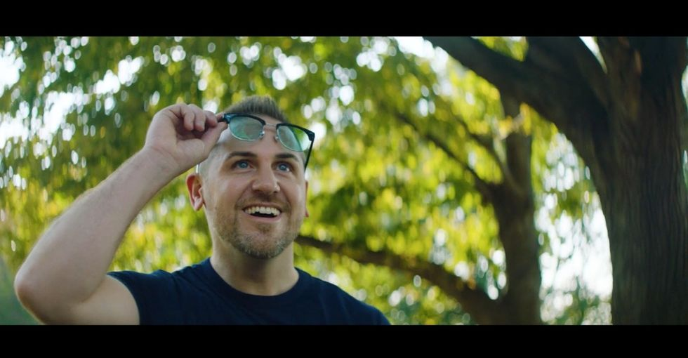 These glasses help colorblind people see colors. Watch this guy put them on.