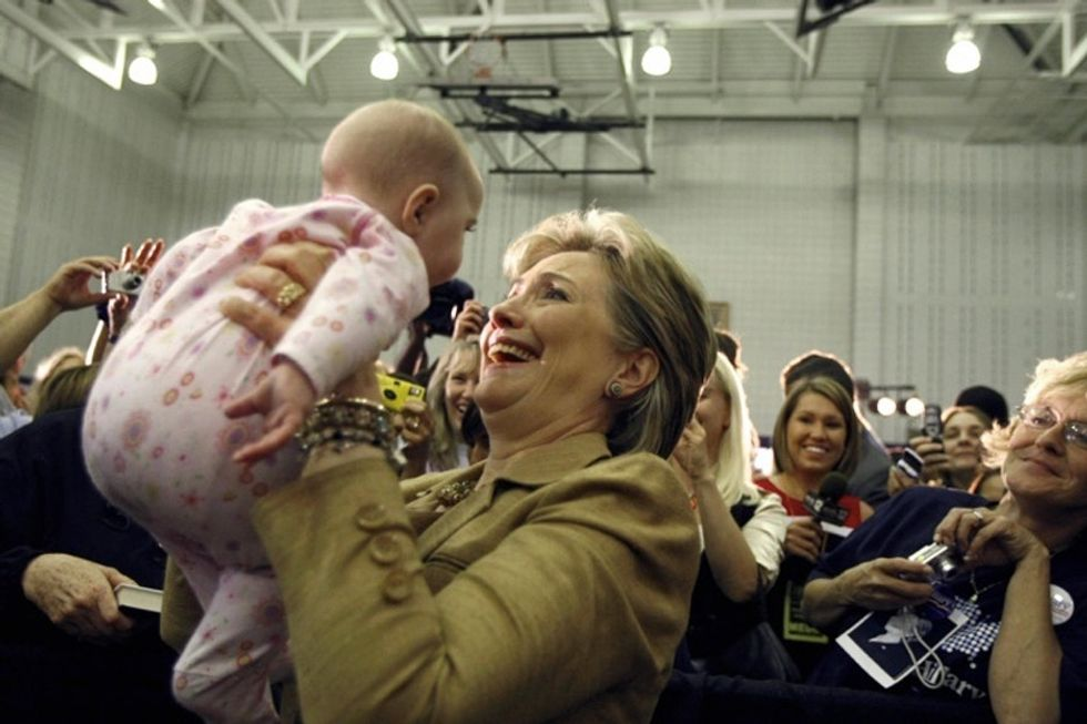 Ever wonder why politicians kiss babies? The answer is weirder than you think.