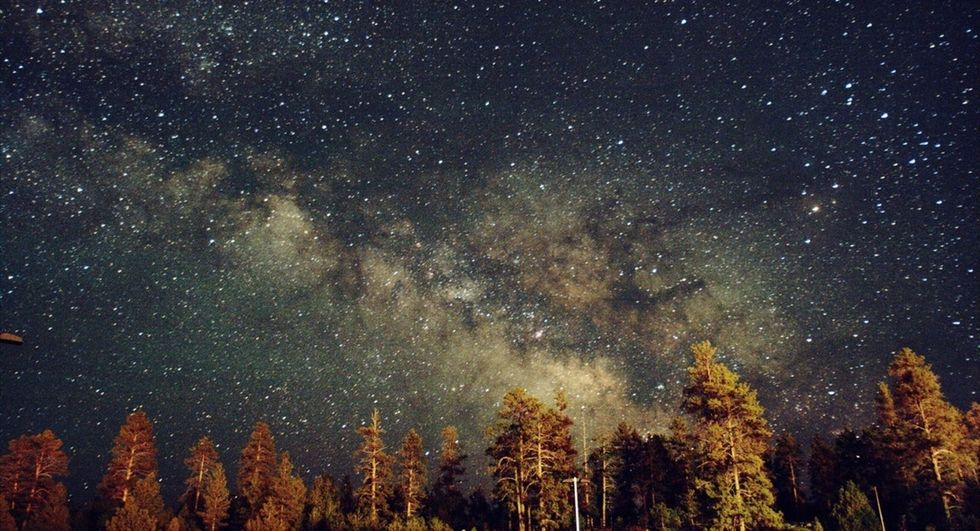 Hidden behind our own galaxy are clues to a mystery of epic proportions.