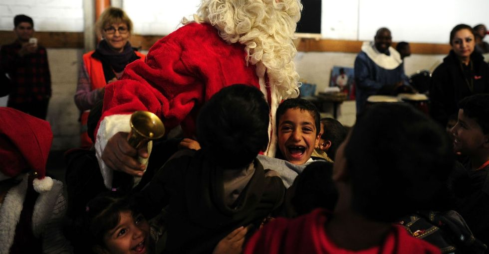 12 touching photos from Santa's visit to a refugee shelter in Germany.