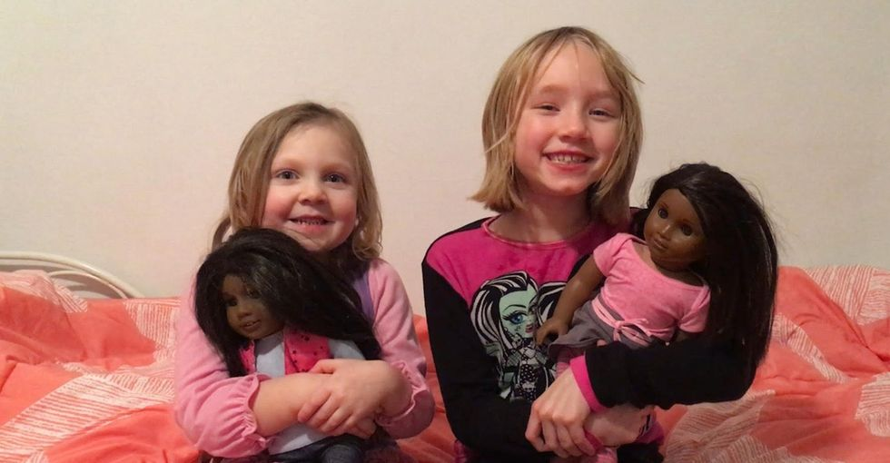 Two white girls were given black dolls and reacted oppositely. Here's why.