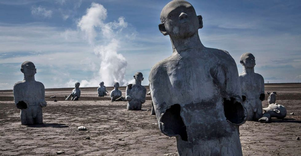 The haunting reason these sculptures were designed to sink slowly into the mud.