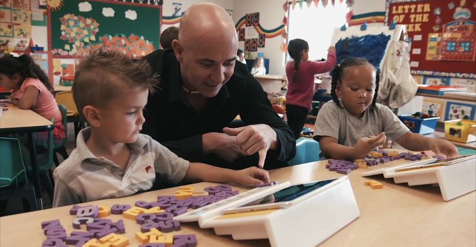Tennis legend Andre Agassi is trying to teach kids to read in a new, very fascinating way.