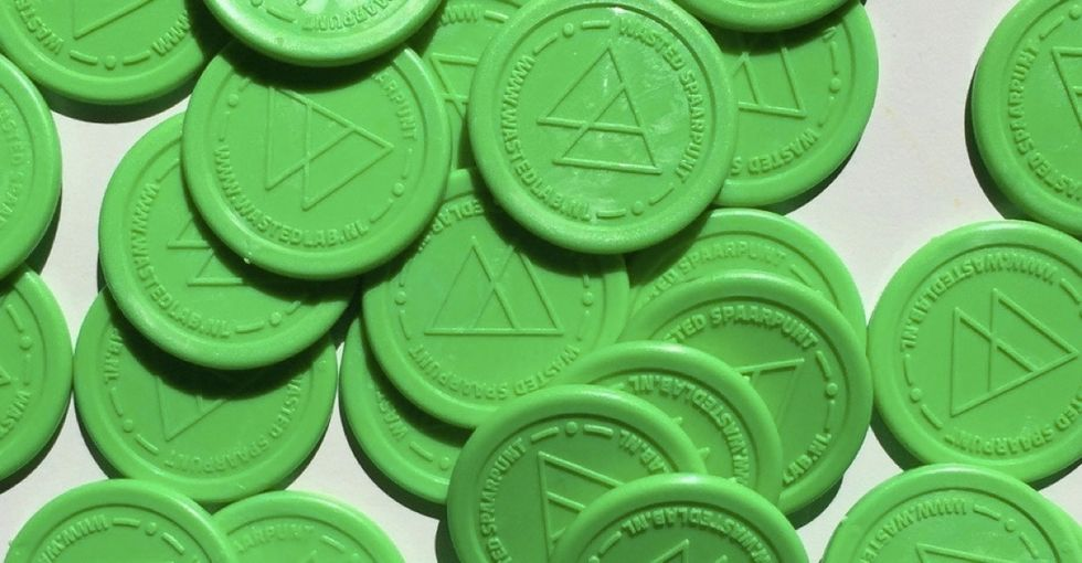 The cool reason why these green coins are becoming a currency in Amsterdam.