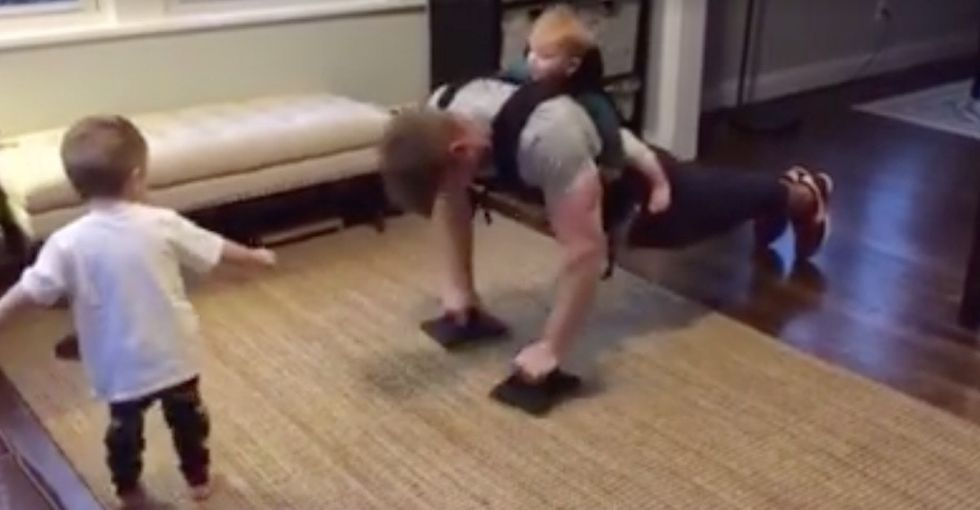 An awesome dad created an adorable home workout video to show how he bonds with his kids.