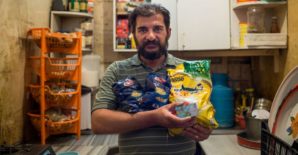 How some Syrian refugees can pay for food with the blink of an eye.