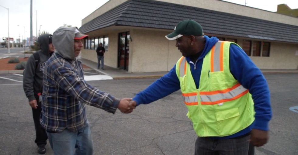 Here's how one city's plan to pay panhandlers for work is doing a year later.