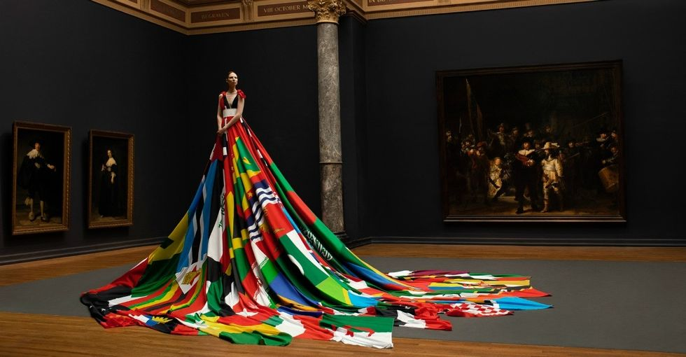 Trans model stuns in dress made from flags of countries where being LGBTQ is illegal.