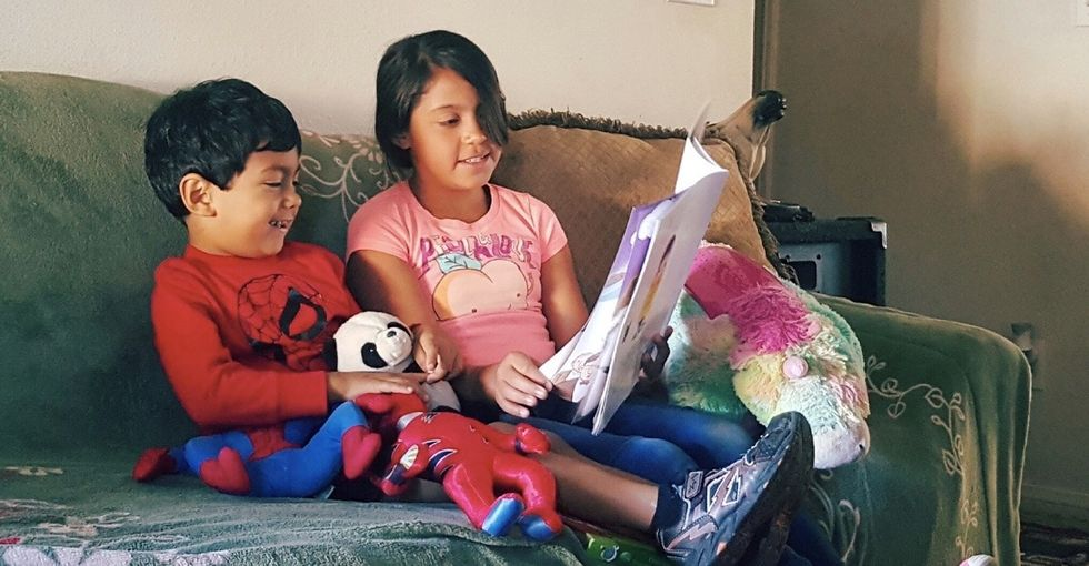 When older siblings read to younger ones, great things happen.