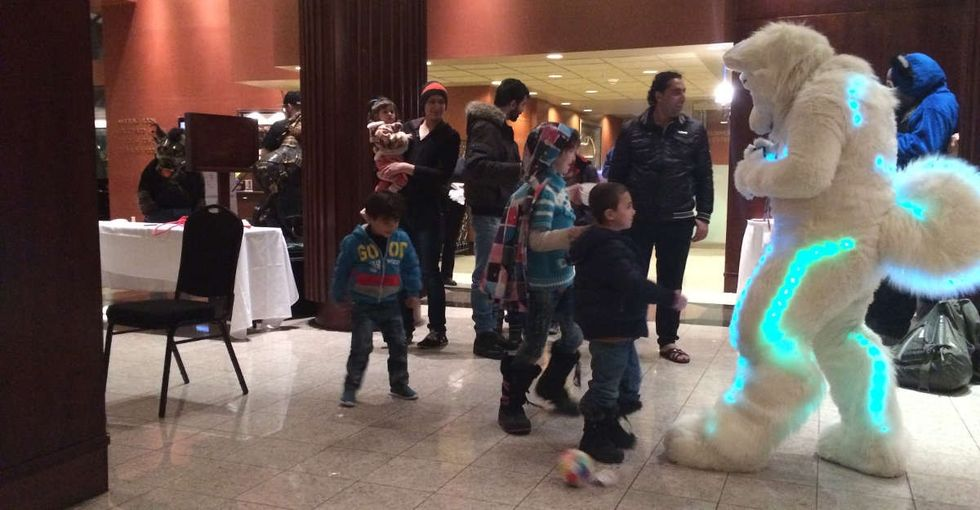 A group of Syrian refugees wandered into a furry convention — and magic happened.