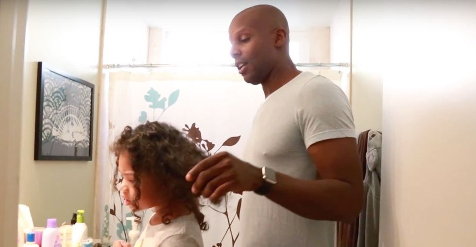 A photo of this dad doing his girl's hair went viral. Now he has something to say.