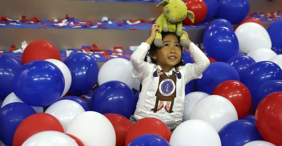 18 moving photos show the ripple effect of a female presidential candidate.