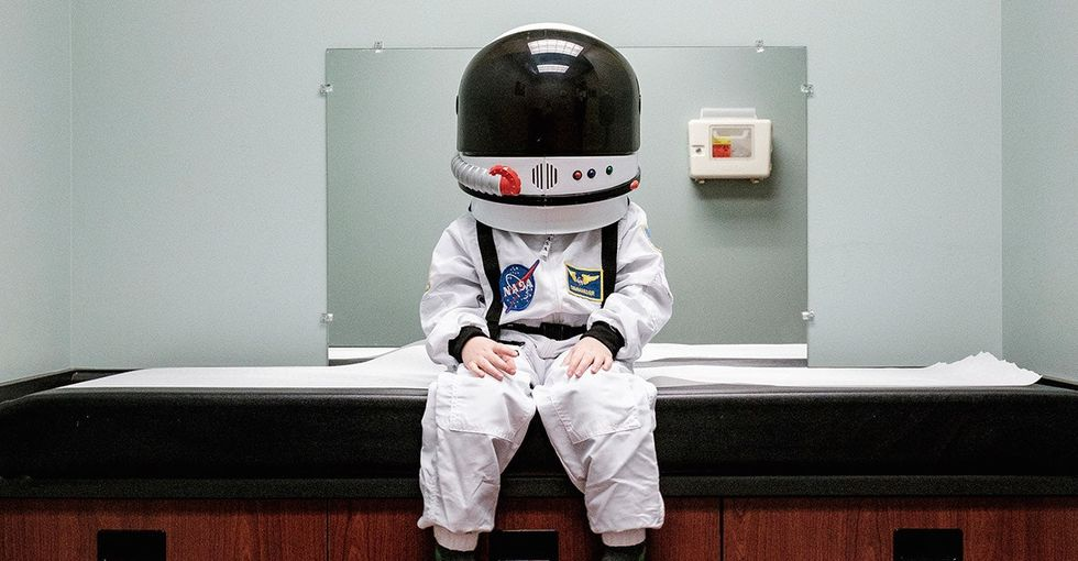A dad took these touching photos of his 'astronaut' son exploring planet Earth.