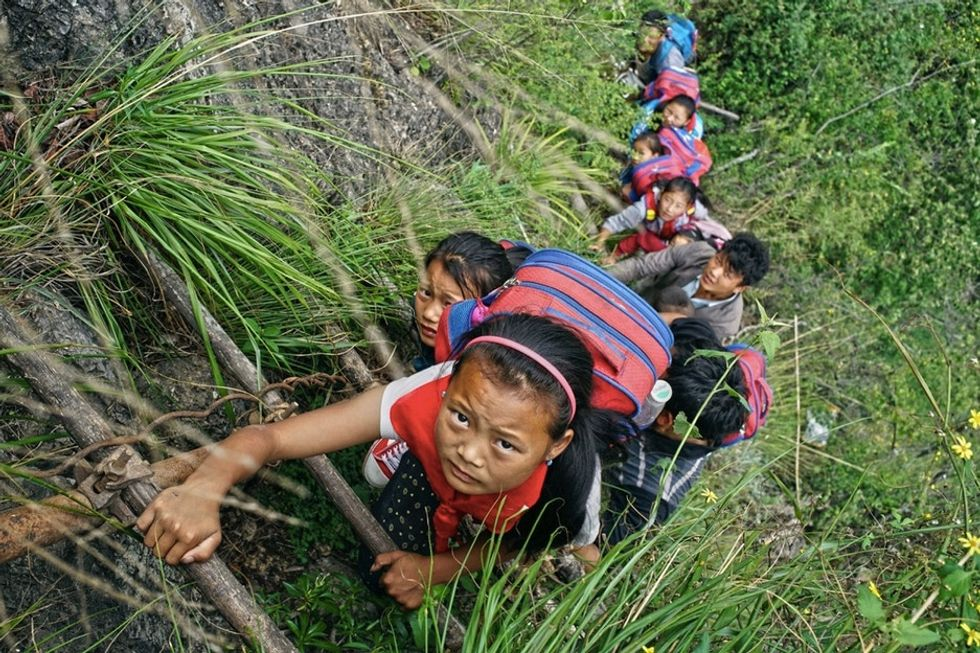 There's no bus, so these kids climb down a 2,600-foot ladder to school.