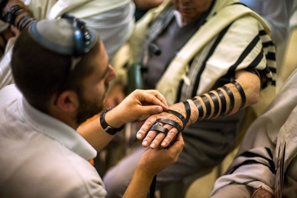 See the emotional moment 50 Holocaust survivors finally got bar mitzvahed.