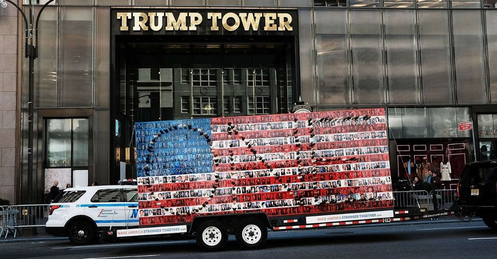 An artist made a two-sided painting, strapped it to a truck, and drove it to Trump Tower.