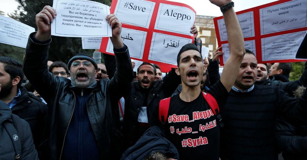 8 powerful pics show how people around the world are standing with Aleppo.