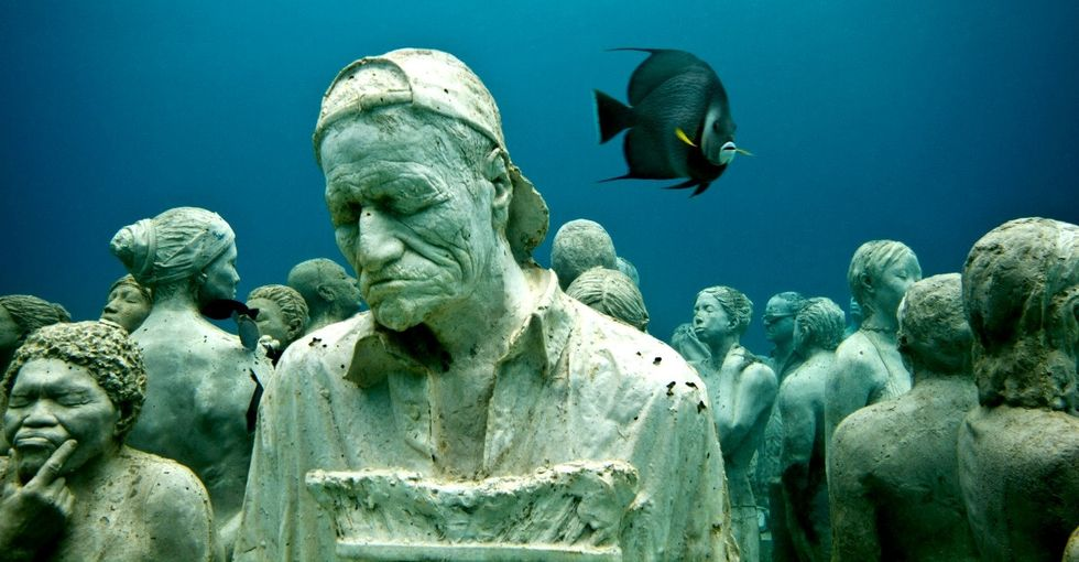 Creepy? Yes. Beautiful, too. These underwater statues may help save our coral reefs.