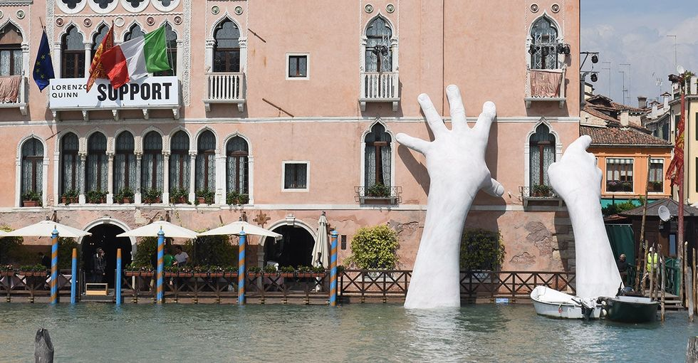 A pair of god-like hands emerged from a Venice canal. Here's how they got there.