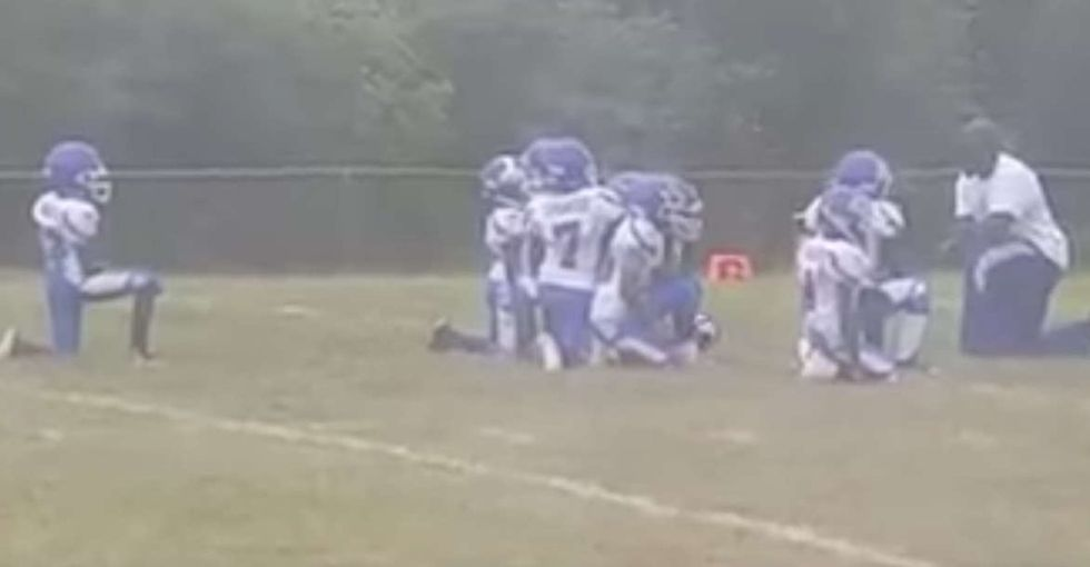 After a shocking verdict in St. Louis, these 8-year-olds protested on the football field.
