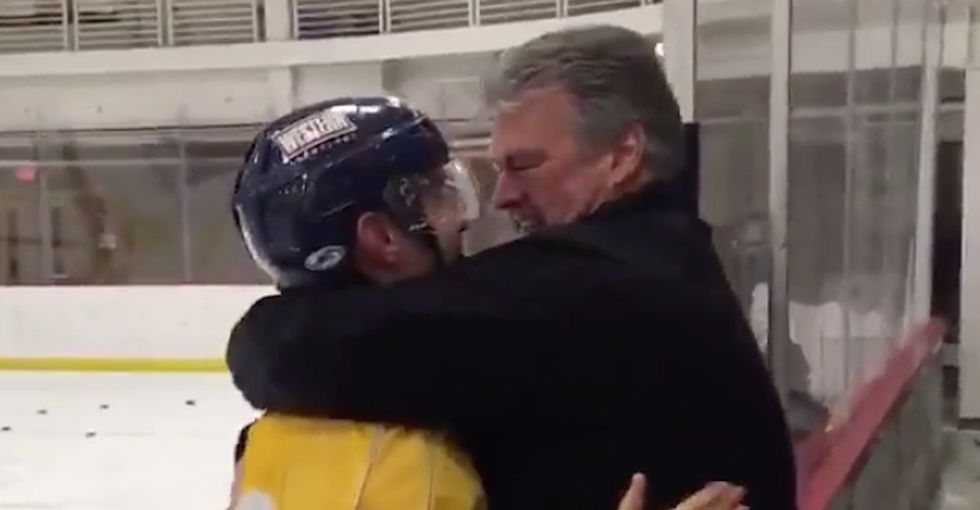 This father-son hockey hug is going viral, and it's a great example of male affection.