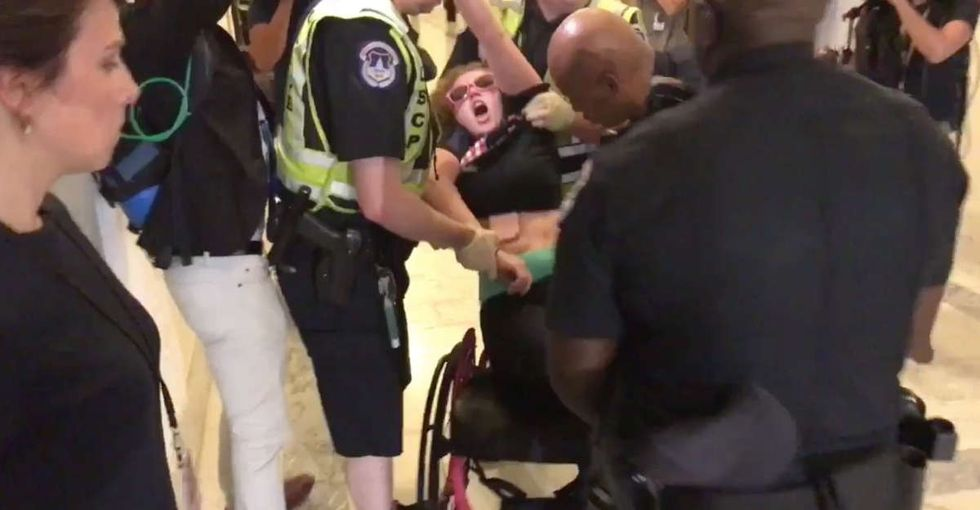 A woman dragged from her wheelchair for protesting the health care bill speaks out.
