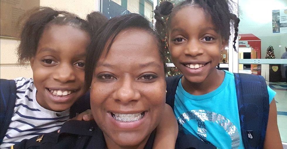 She suffered abuse as a child. Now she's a cop dedicated to making kids' lives better.