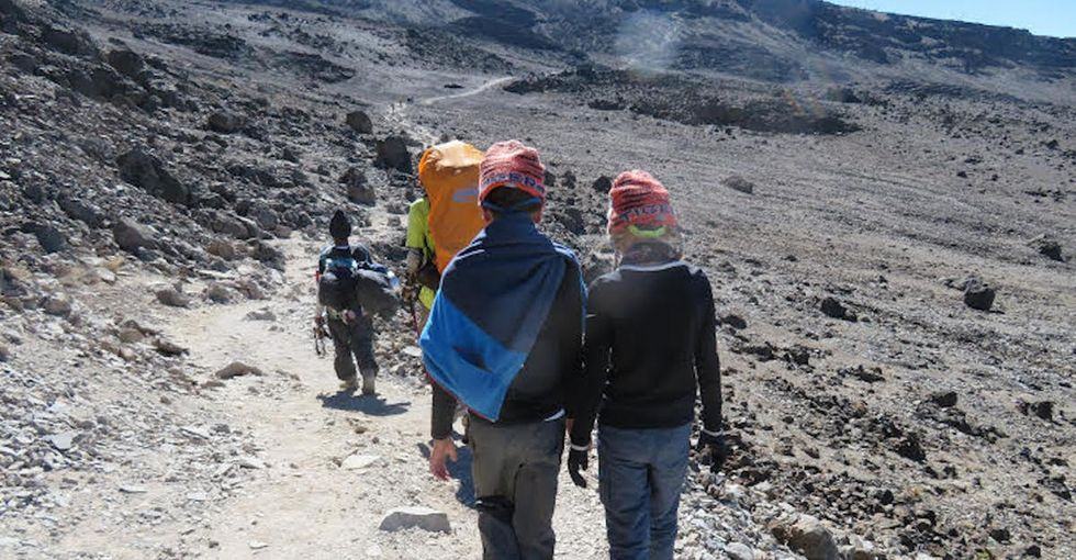 This family beat medical odds to climb the highest mountain in Africa. They set a record.