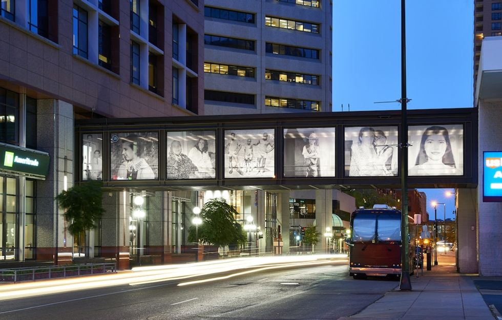 An artist gathered immigrants' photos and stories then hung them for the city to see.