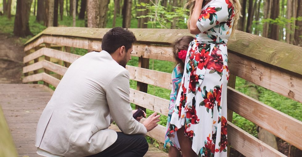 See the heart-bursting moment a man 'proposed' to his girlfriend's 5-year-old daughter.
