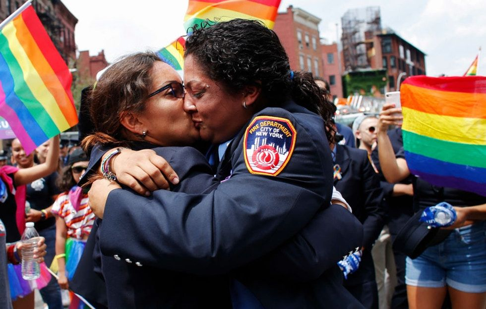 These firefighter medics stole the Pride spotlight with their surprise wedding proposal.