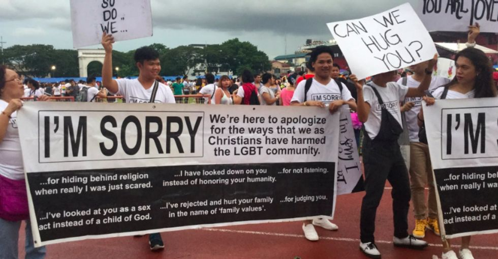 They went to Pride with 'I'm sorry' signs, and people are feeling all the feels.