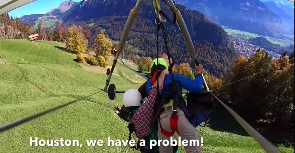 Hang glider caught in heart racing ordeal after realizing he's not strapped in.